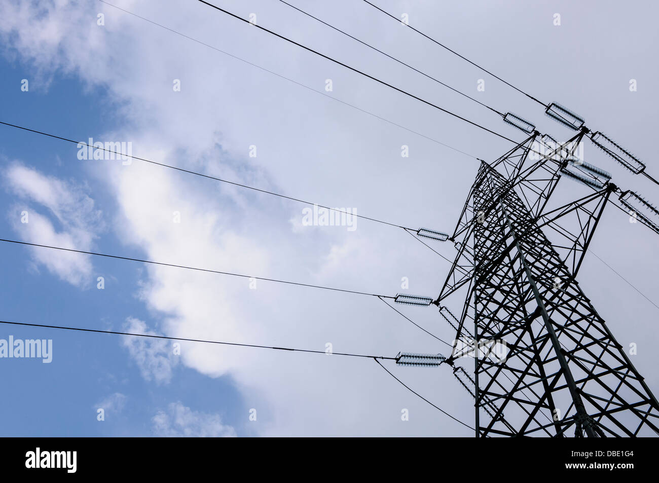 High voltage power tower and cables used for distributing electricity - Stock Image