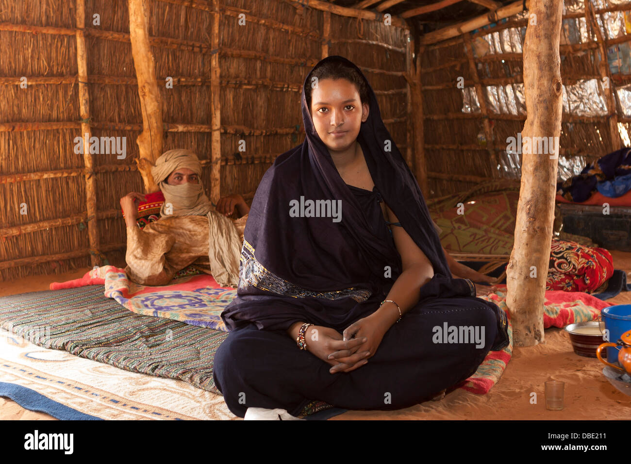 Inside Tuareg tent made from woven mats with village chief, in the home of his married daughter and her husband, Stock Photo
