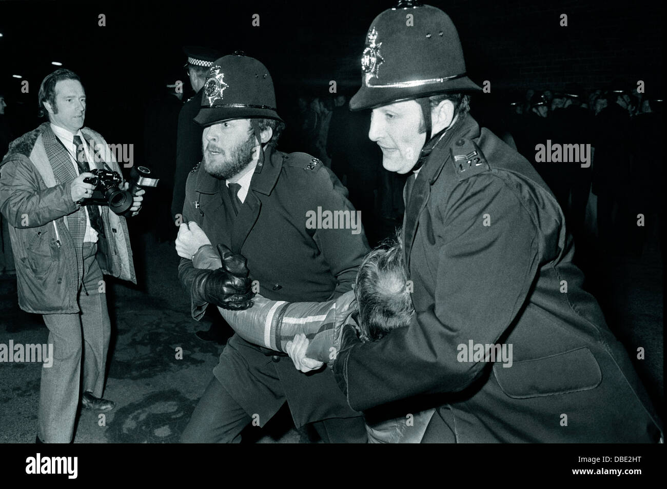 Police arrest a striking picket at Hadfields private steel works in Sheffield during the 1980 National Steel Strike - Stock Image