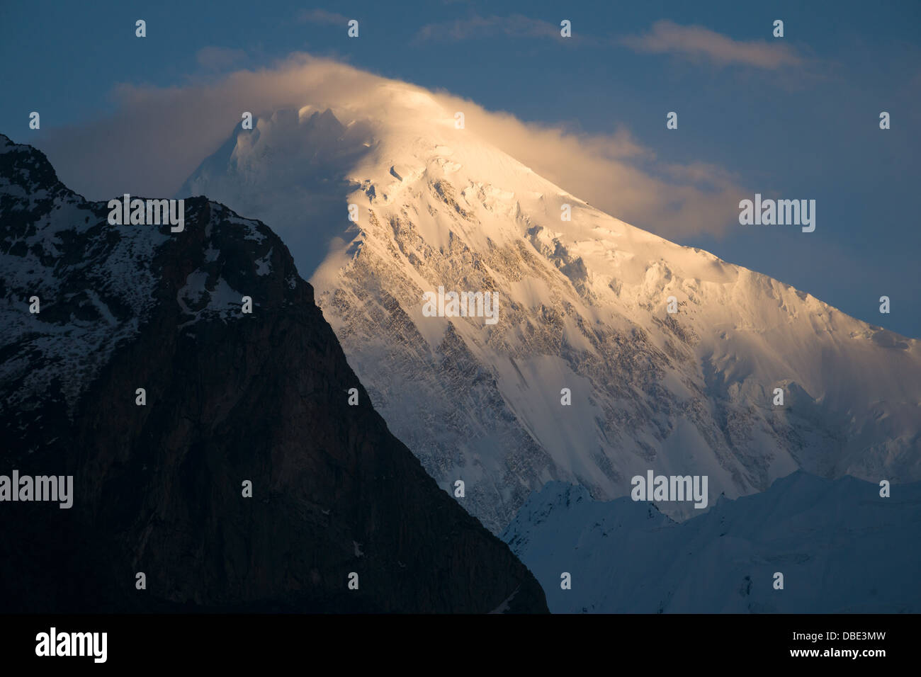 Diran Peak seen from Karimabad at sunset, Hunza Valley, Gilgit-Baltistan, Pakistan - Stock Image