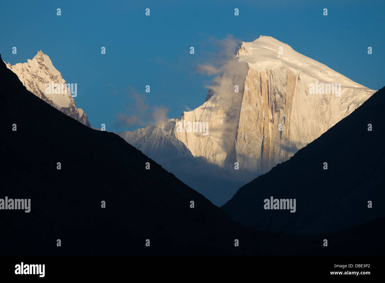 Spantik (Golden Peak) seen from Karimabad at sunset, Hunza Valley, Gilgit-Baltistan, Pakistan - Stock Image