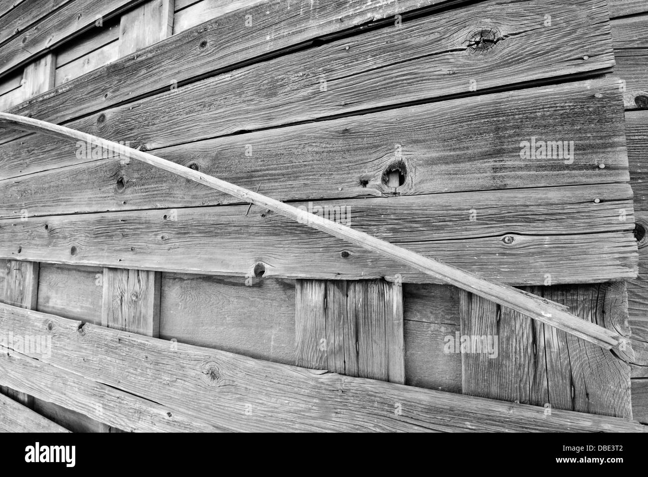 Wood plank peeling of a the exterior wall of an abandoned building on Oregon's Zumwalt Prairie. - Stock Image