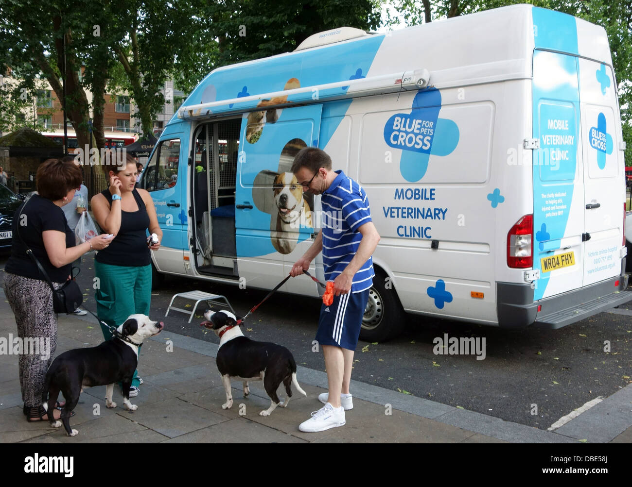 Blue Cross mobile veterinary clinic parked by Islington Green, London - Stock Image
