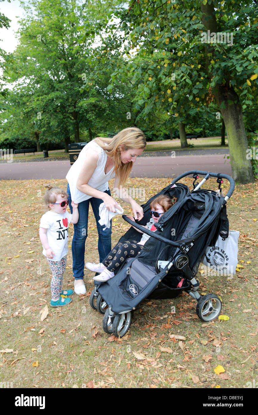 Mother with twin girls - Stock Image