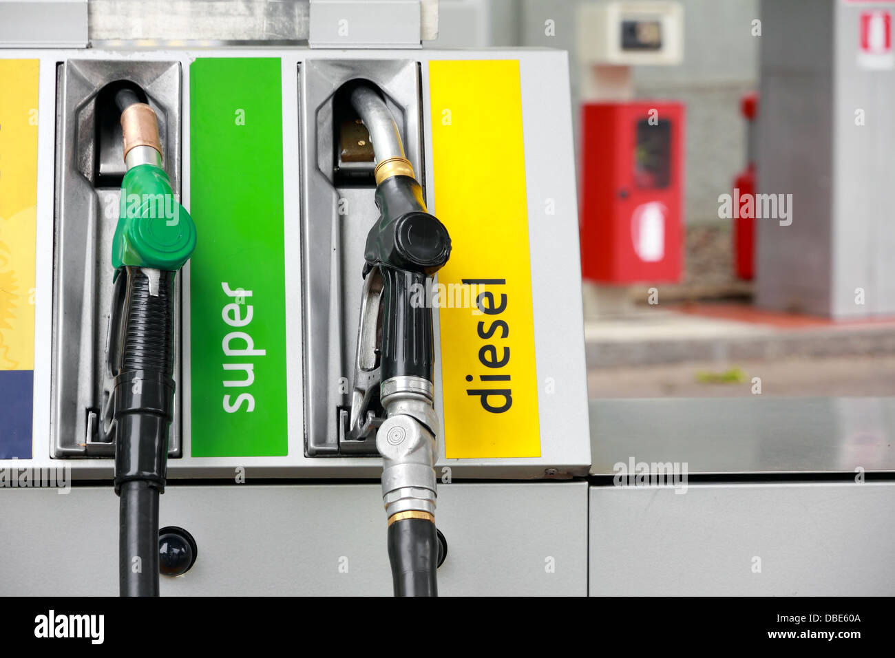 Pump nozzles in gas station - Stock Image