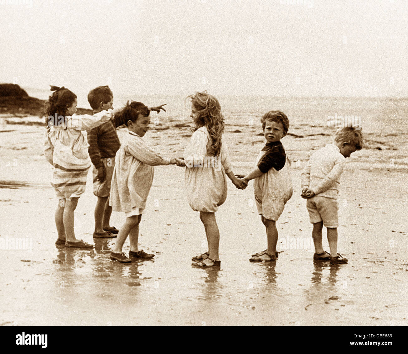 Children Playing on the Beach Victorian period - Stock Image