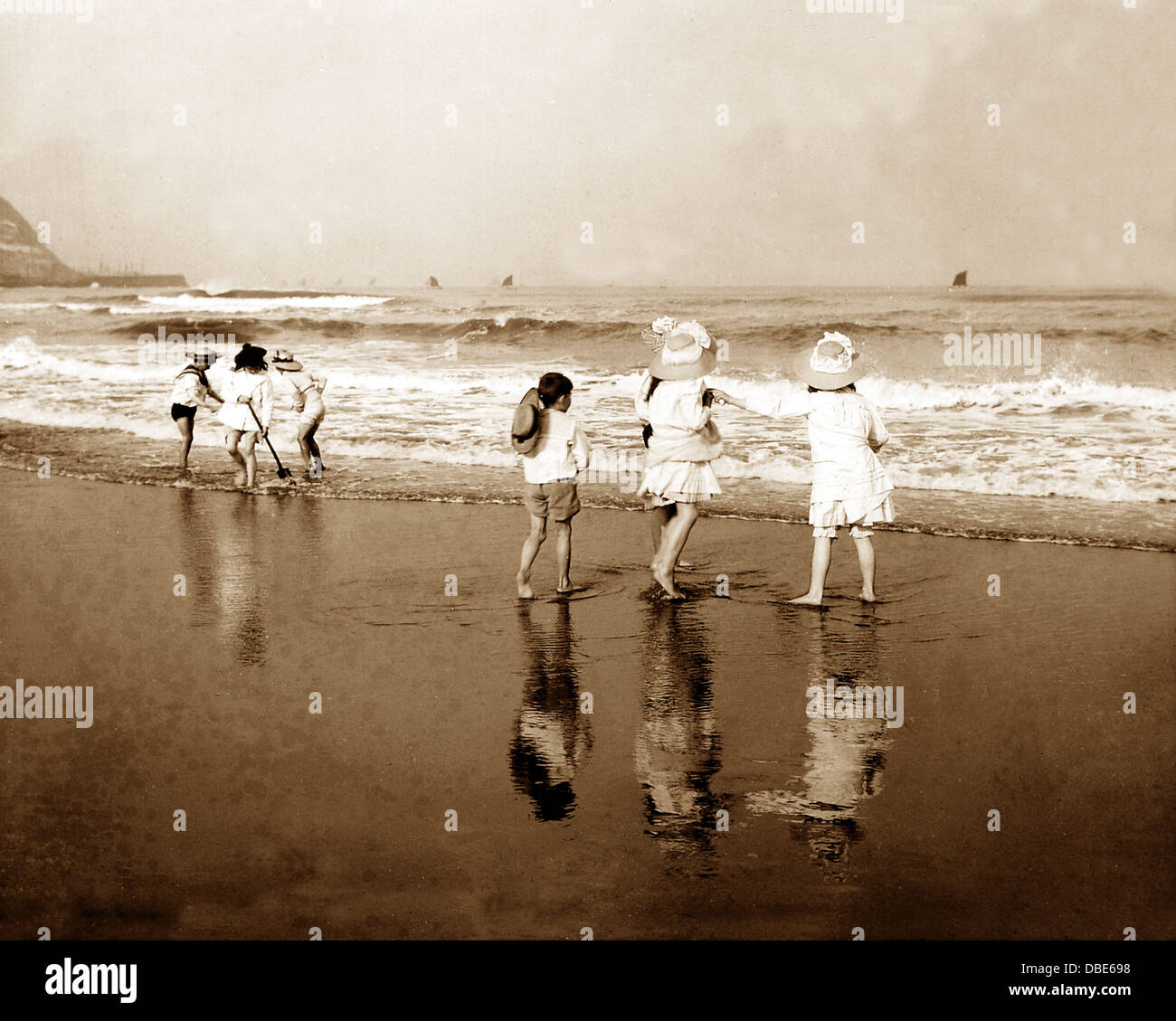 Children on the Beach Victorian period - Stock Image