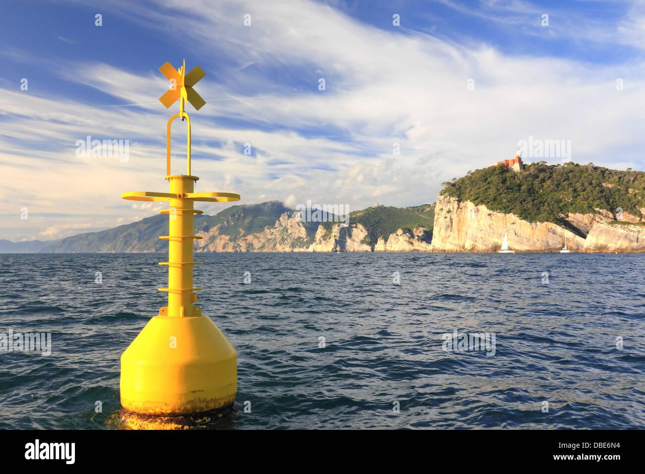 floating yellow buoy on mediterranean coast in front of portovenere, la spezia, italy - Stock Image