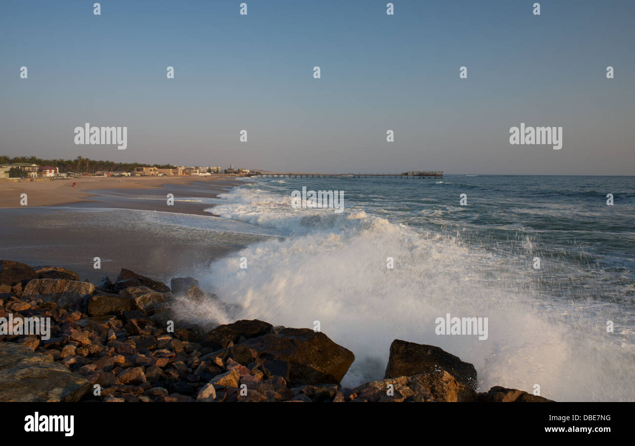 Crashing waves at sunset in Swakopmund namibia Africa - Stock Image