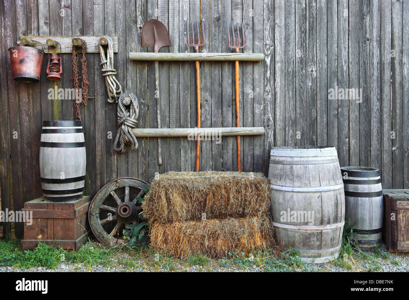 Barrel bale and fork in old barn - Stock Image