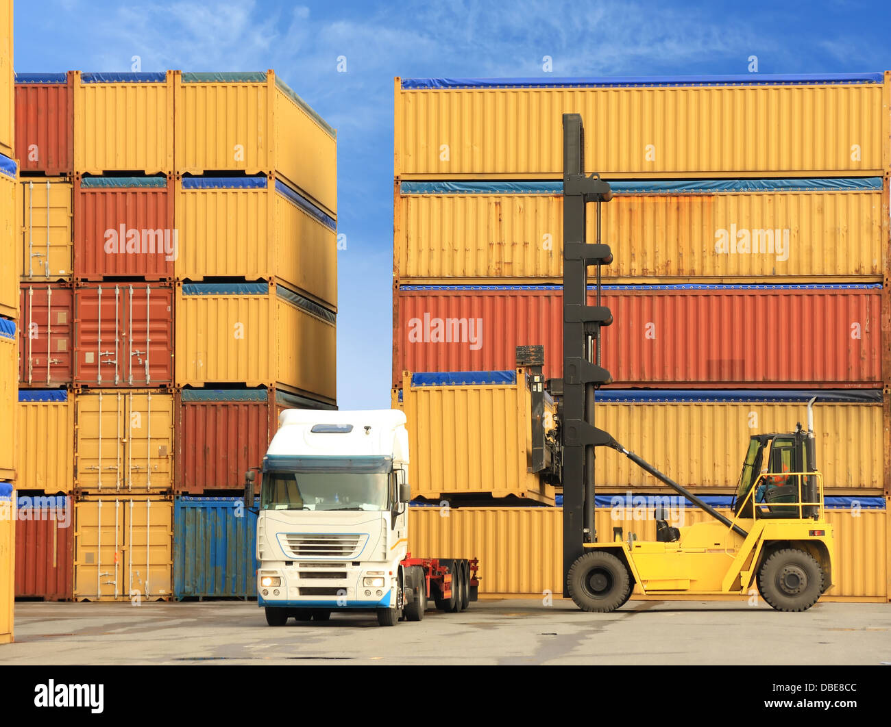 Forklift and truck with shipping containers - Stock Image