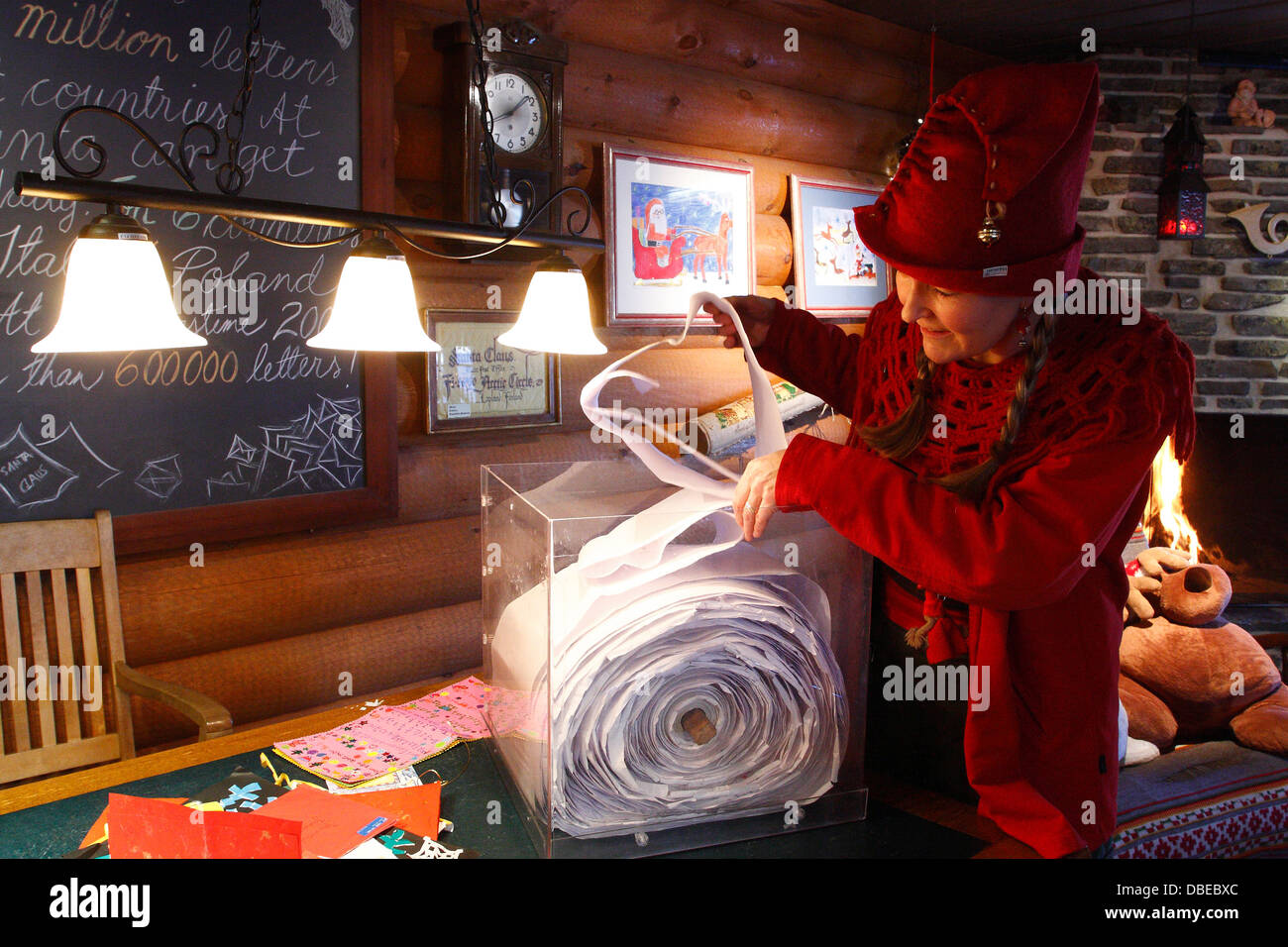 Elf reading a letter in Santa Claus Village, Rovaniemi, Lapland, Finland - Stock Image