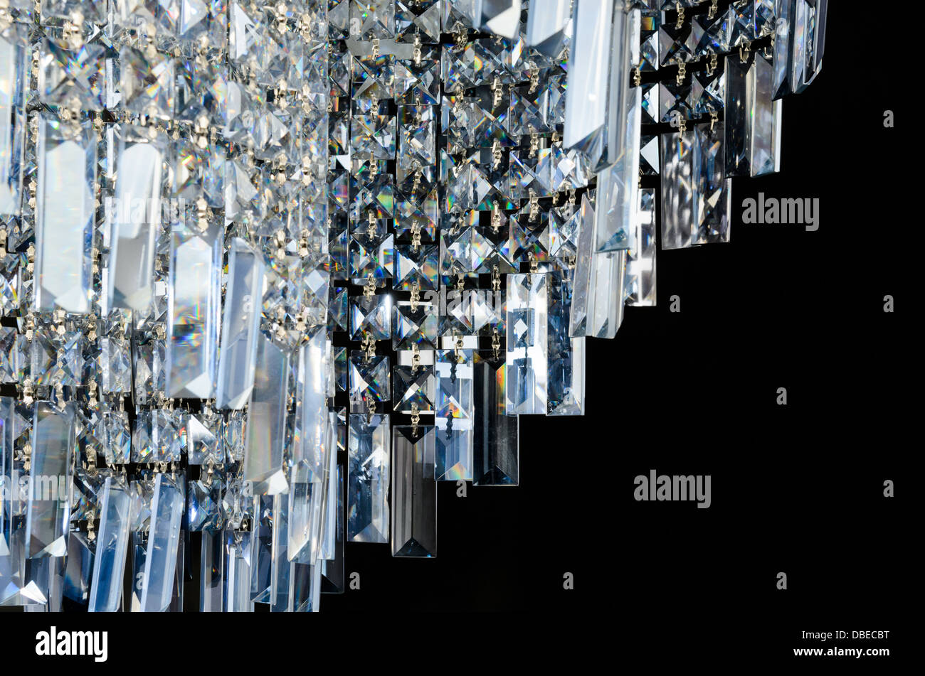 Contemporary glass chandelier crystal isolated over black background Stock Photo
