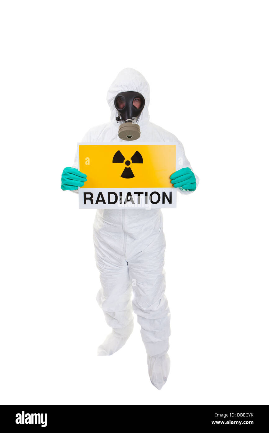 A man in a hazmat suit holding a sign - Stock Image