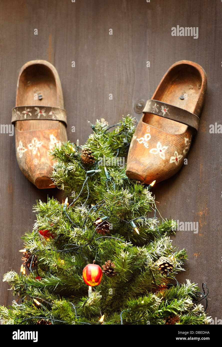 Traditional wooden shoes and fir tree Christmas decoration