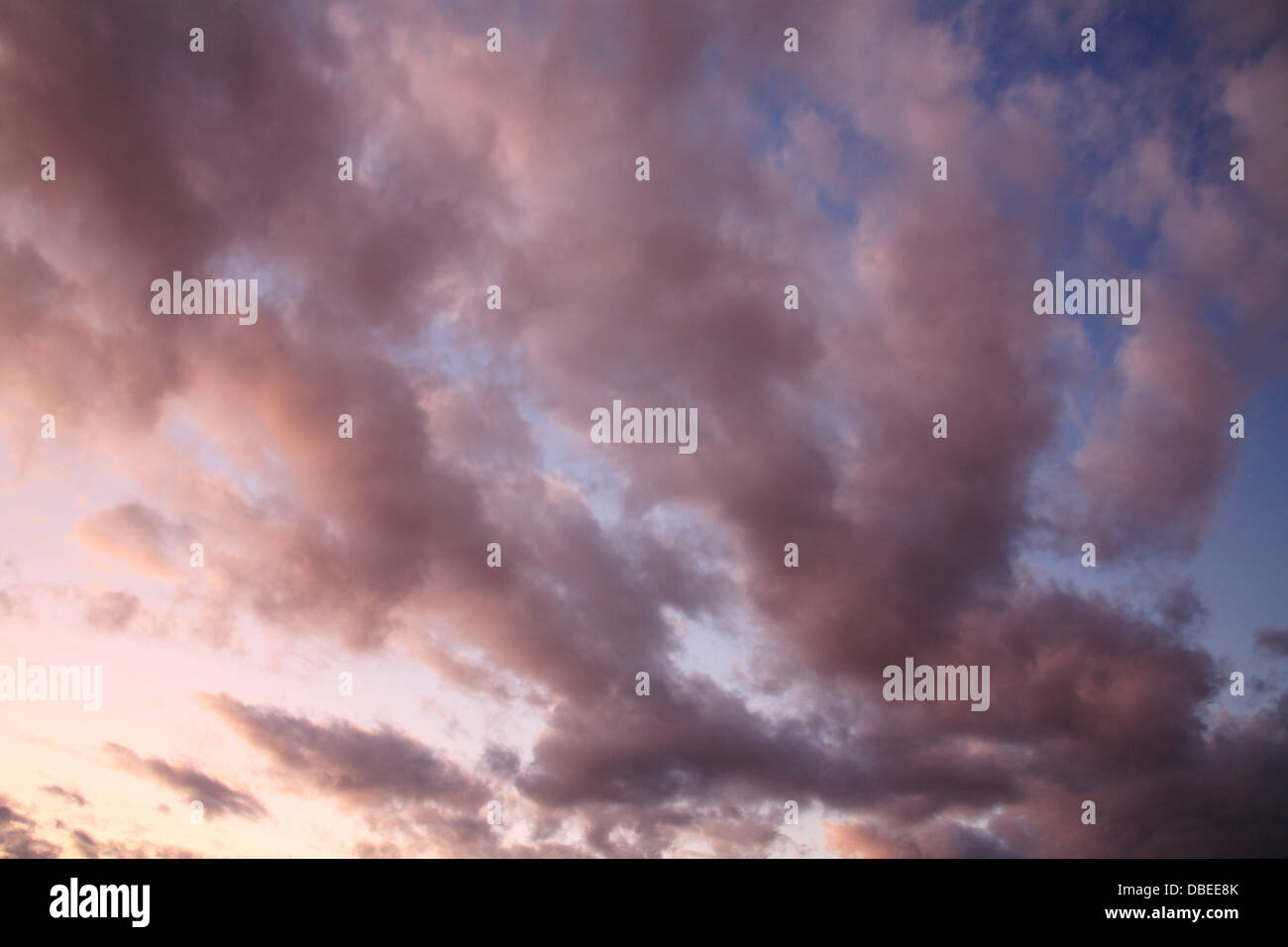Sky And Cloud Scene, A Colorful And Ominous Looking Sunset Cloudscape - Stock Image