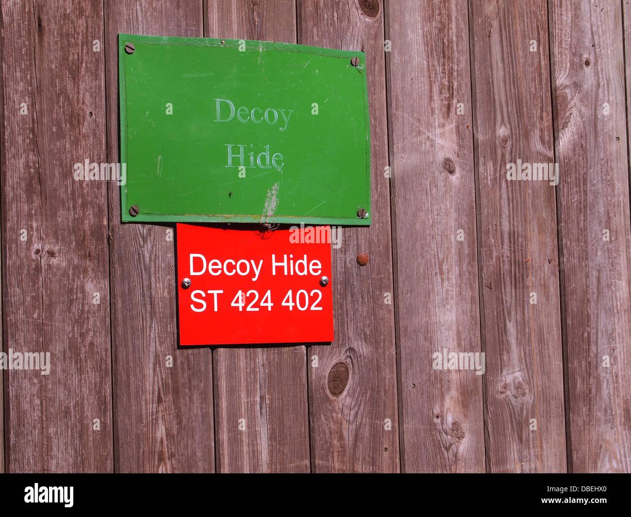 Identification signs on the door of decoy hide near shapwick in somerset july 2013