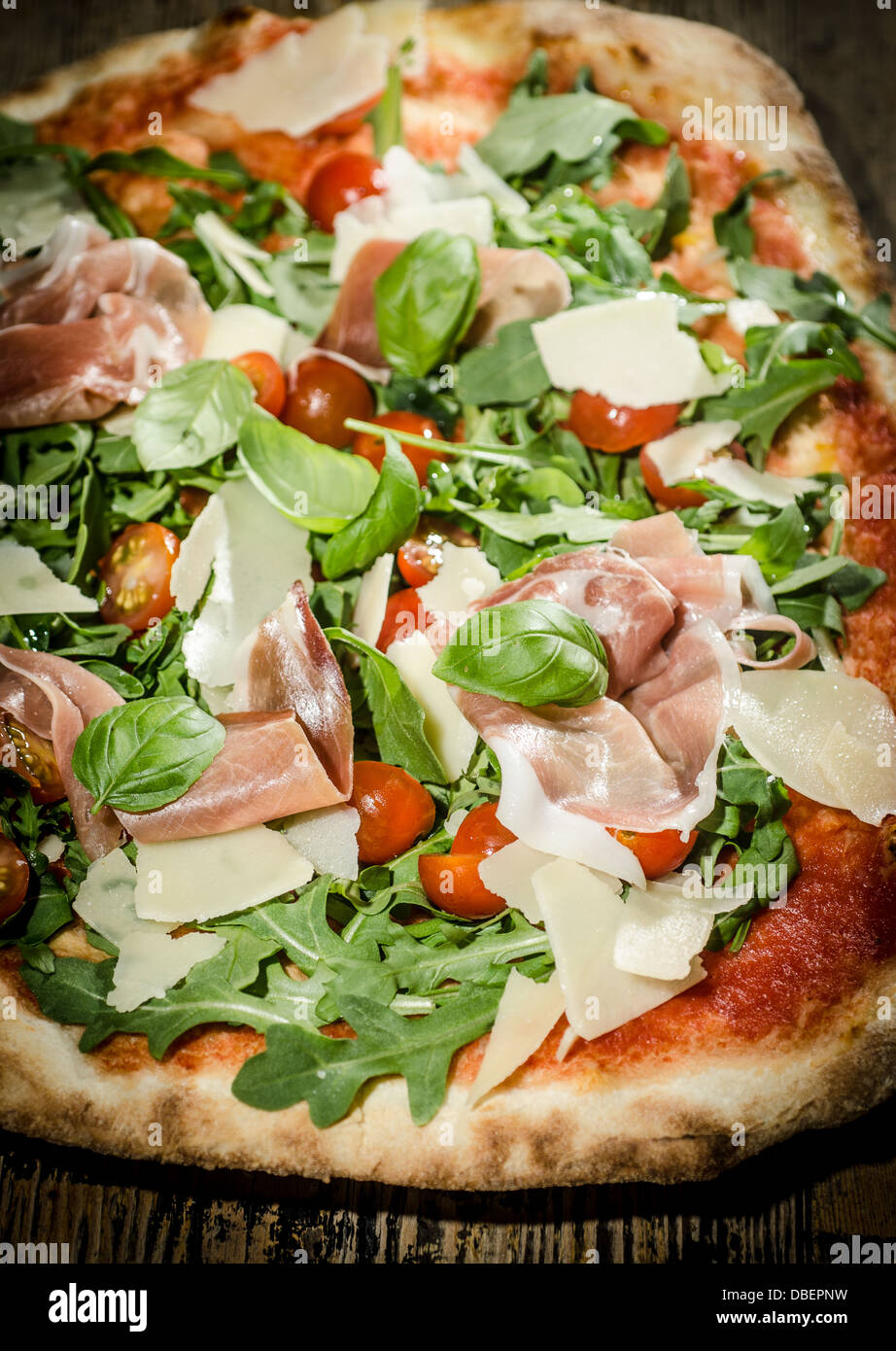Pizza Parma ham and rocket detail - Stock Image