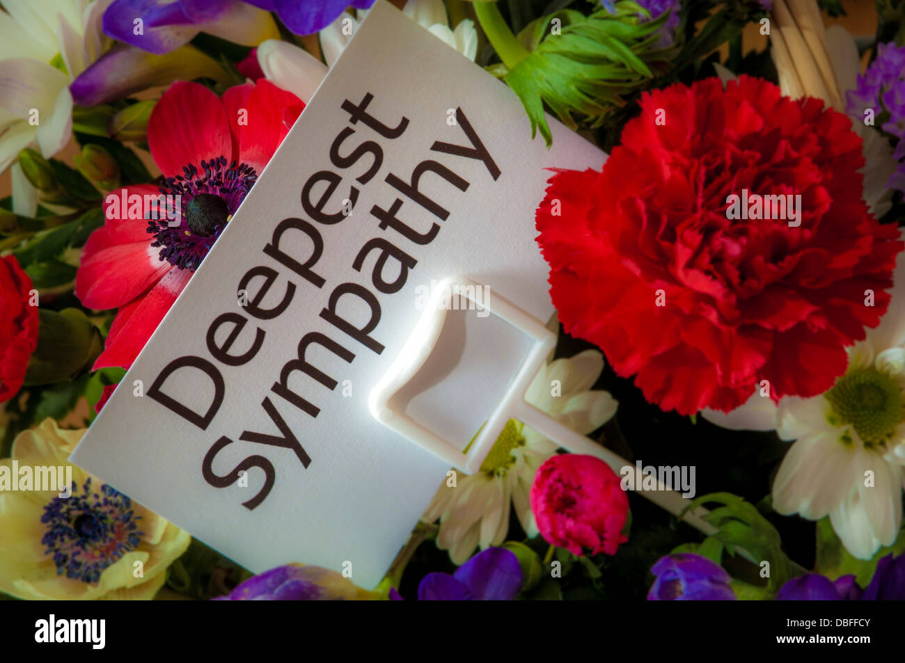 Close up of bouquet of flowers with message card deepest sympathy close up of bouquet of flowers with message card deepest sympathy izmirmasajfo