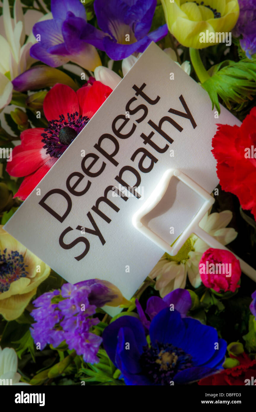 close up of bouquet of flowers with message card deepest
