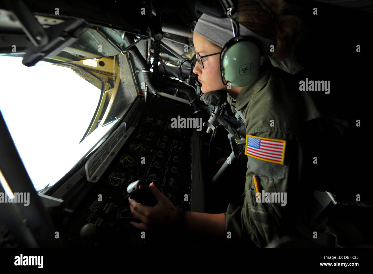 Airman 1st Class Autumn Hedrick-Cox, 384th Air Refueling Squadron boom operator, refuels an F-15 Eagle from the - Stock Image