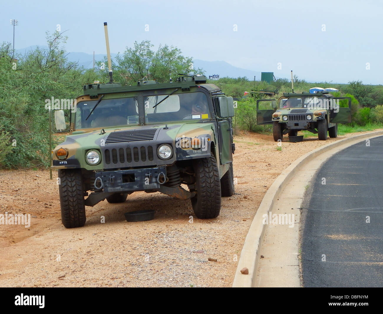Civilians from the U.S. Army Electronic Proving Ground run tests on the Mid-tier Networking Vehicular Radio (MNVR) - Stock Image