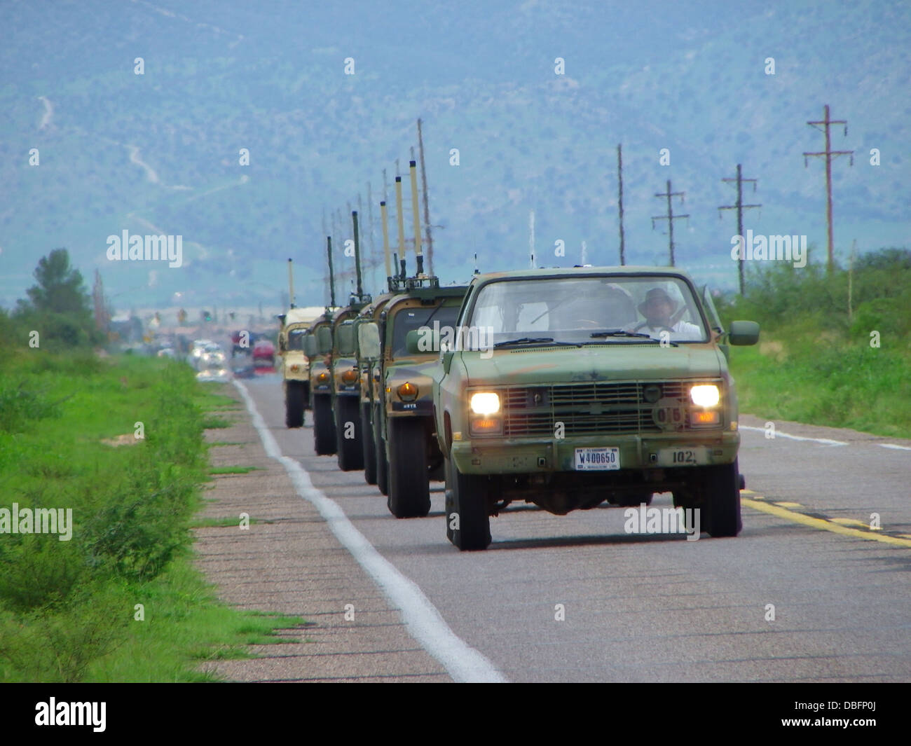 Testers from the U.S. Army Electronic Proving Ground move out for a day of proving the Army's new radio system, - Stock Image