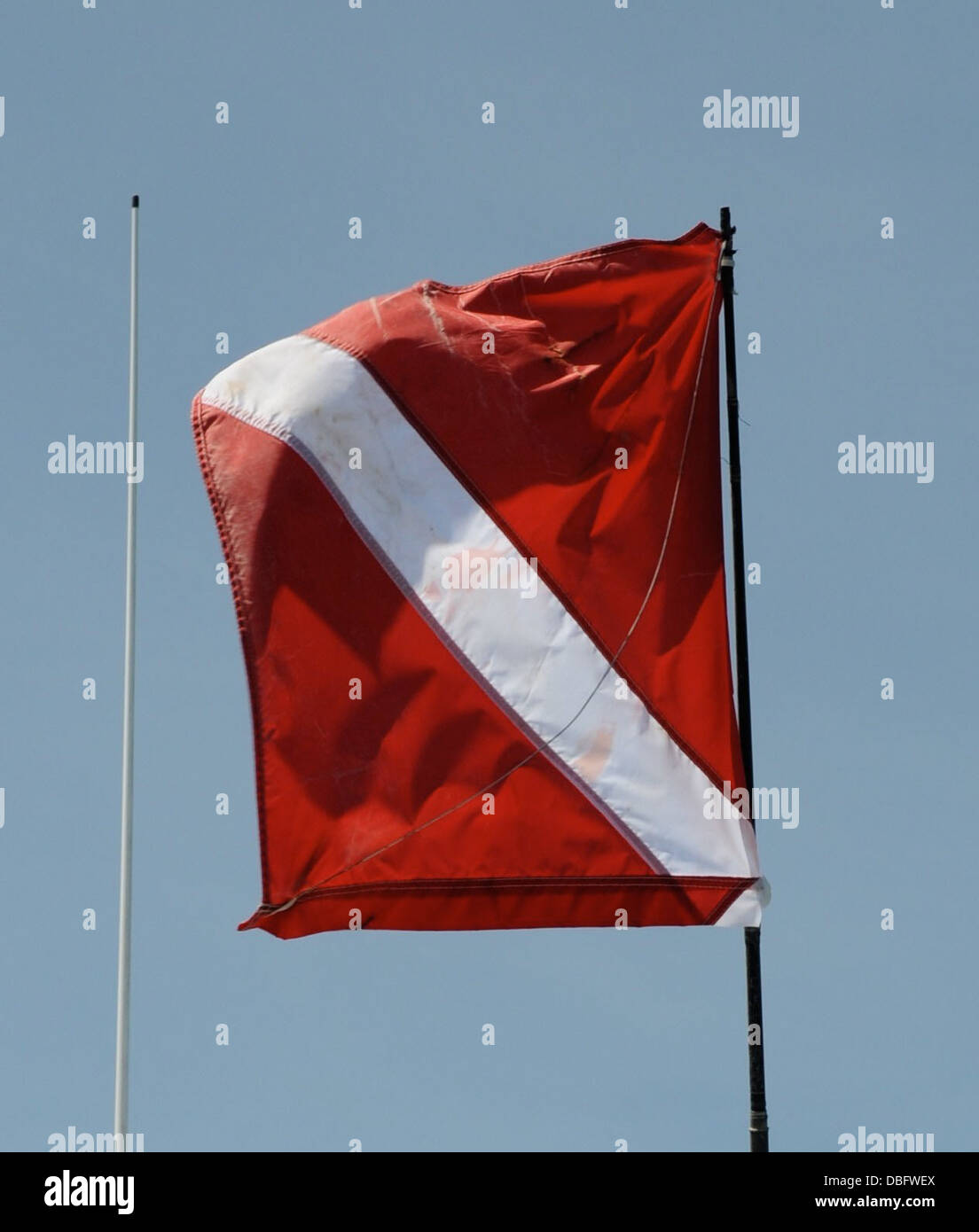 A dive flag is flown to warn incoming boaters of a diver in the water during lobster mini season July 25, 2013. - Stock Image