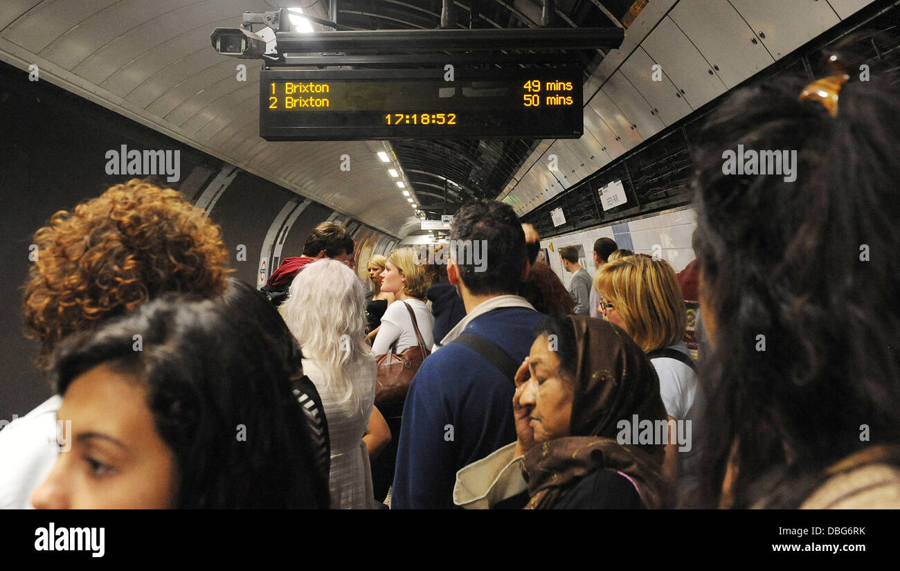 London commuters have a long wait for a train on the Victoria line. A 49 minute wait displays on the board at Green - Stock Image