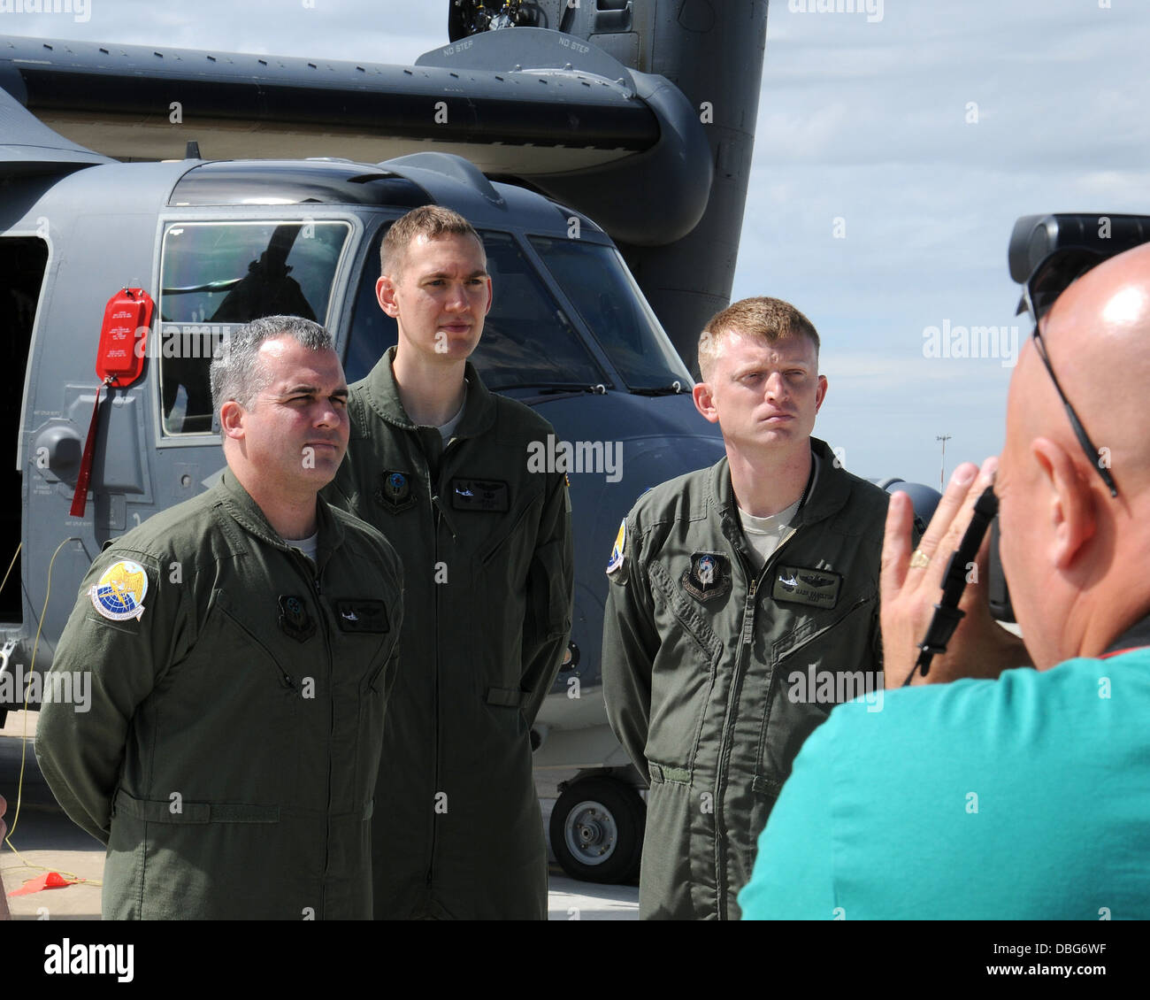 Aircrew members from the 7th Special Operations Squadron pose for photographs from members of the media during a - Stock Image