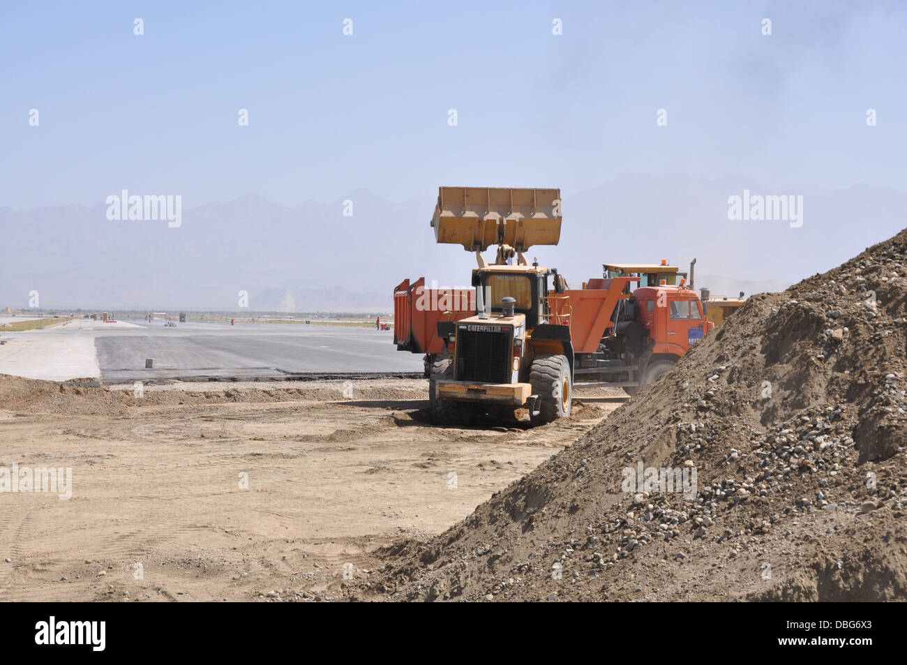 Ongoing runway repairs take place at Bagram Air Field, Afghanistan, July 26, 2013. The first phase of a major runway - Stock Image