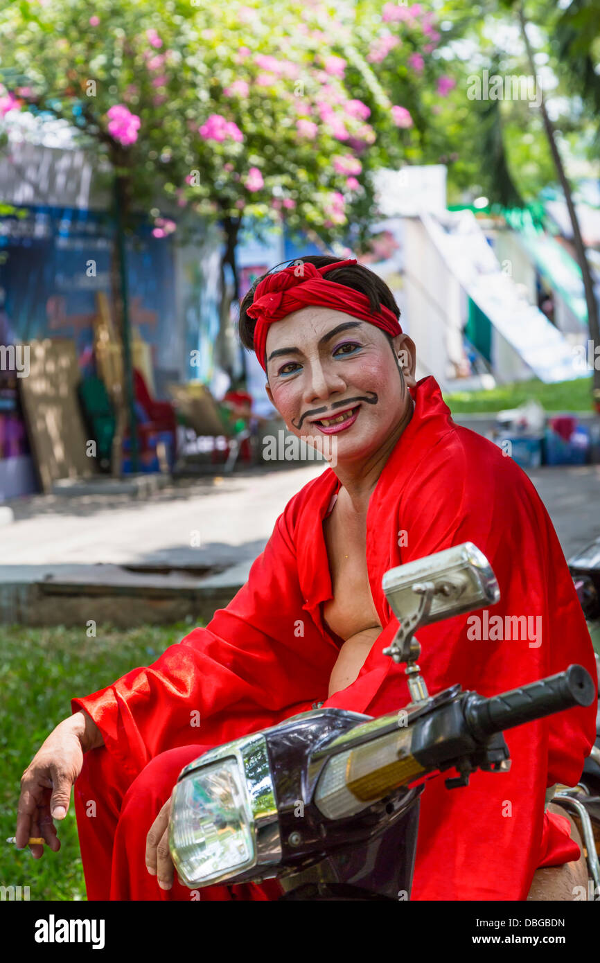 A Vietnamese entertainer on a motorbike in Saigon, Ho Chi Minh City, Vietnam, Asia. - Stock Image