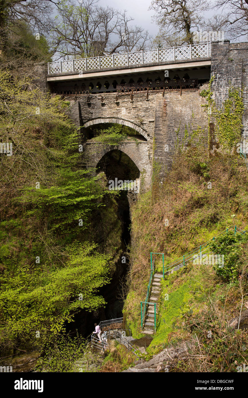 UK, Wales, Ceredigion, Devil's Bridge, visitors at riverside viewing point to see three bridges - Stock Image