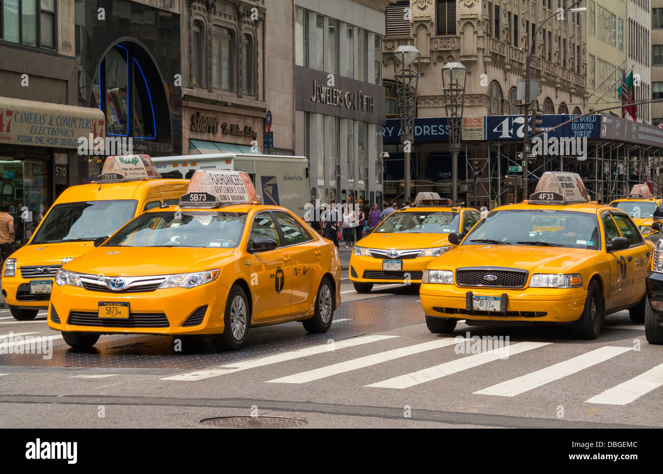 Group of New York taxi cabs at a New York City street junction - Stock Image