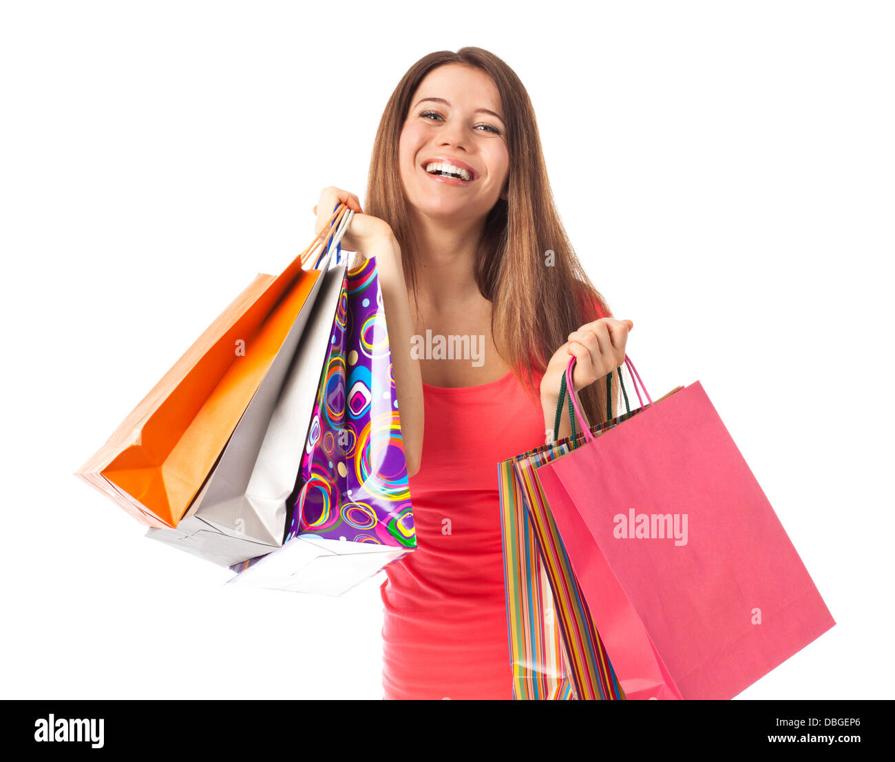 Happy woman with shopping bags, isolated on white - Stock Image