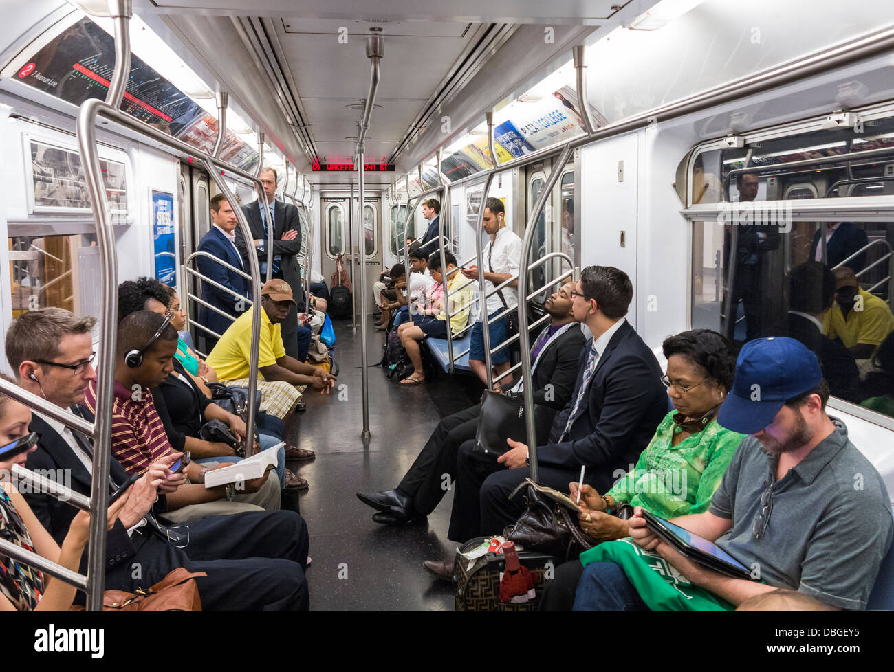 Commuters on the New York City subway in the morning - Stock Image