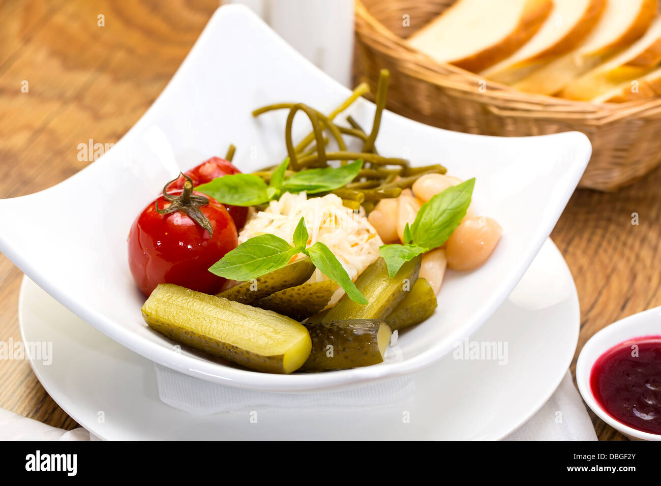 pickled vegetables, cucumber tomatoes asparagus and garlic cabbage Stock Photo