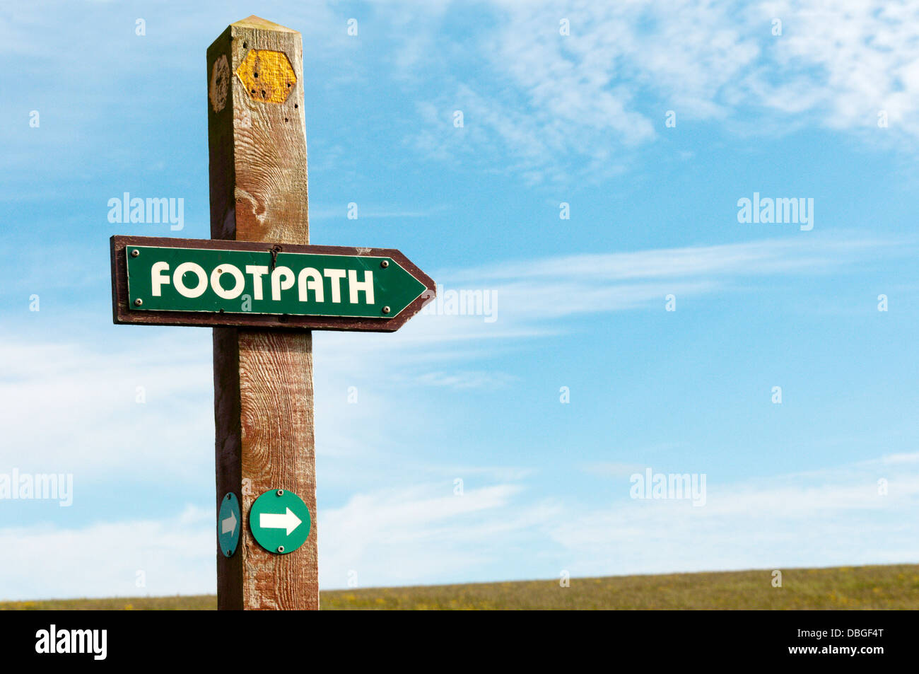 A footpath direction sign in the countryside. Stock Photo