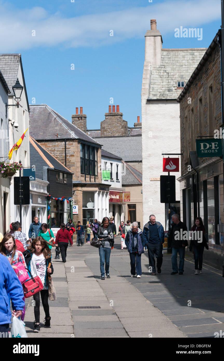 Albert Street, the main shopping street in Kirkwall, Mainland, Orkney. - Stock Image