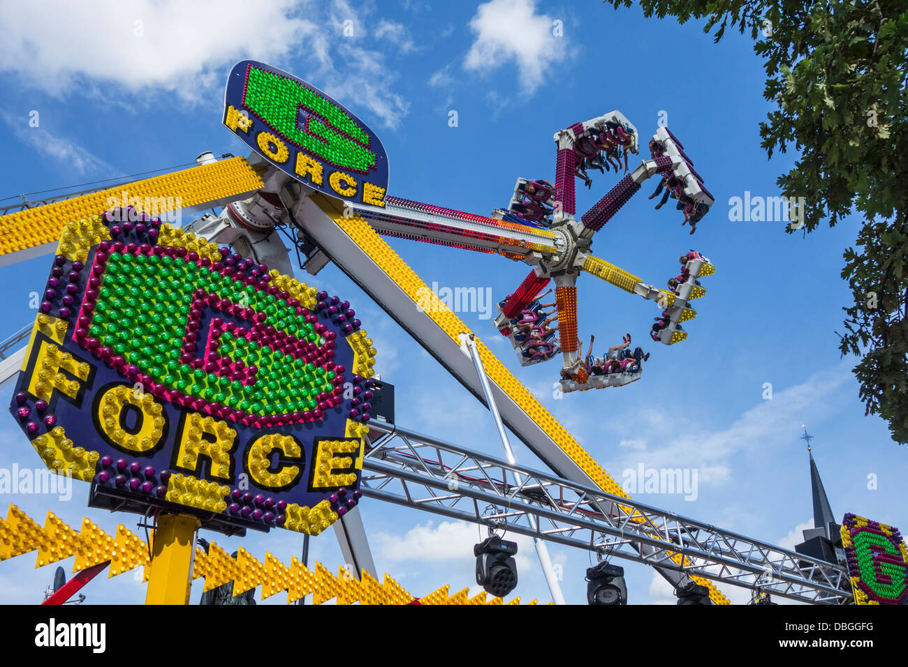 Excited thrillseekers / thrill seekers having fun on the fairground attraction G Force at travelling funfair / traveling - Stock Image