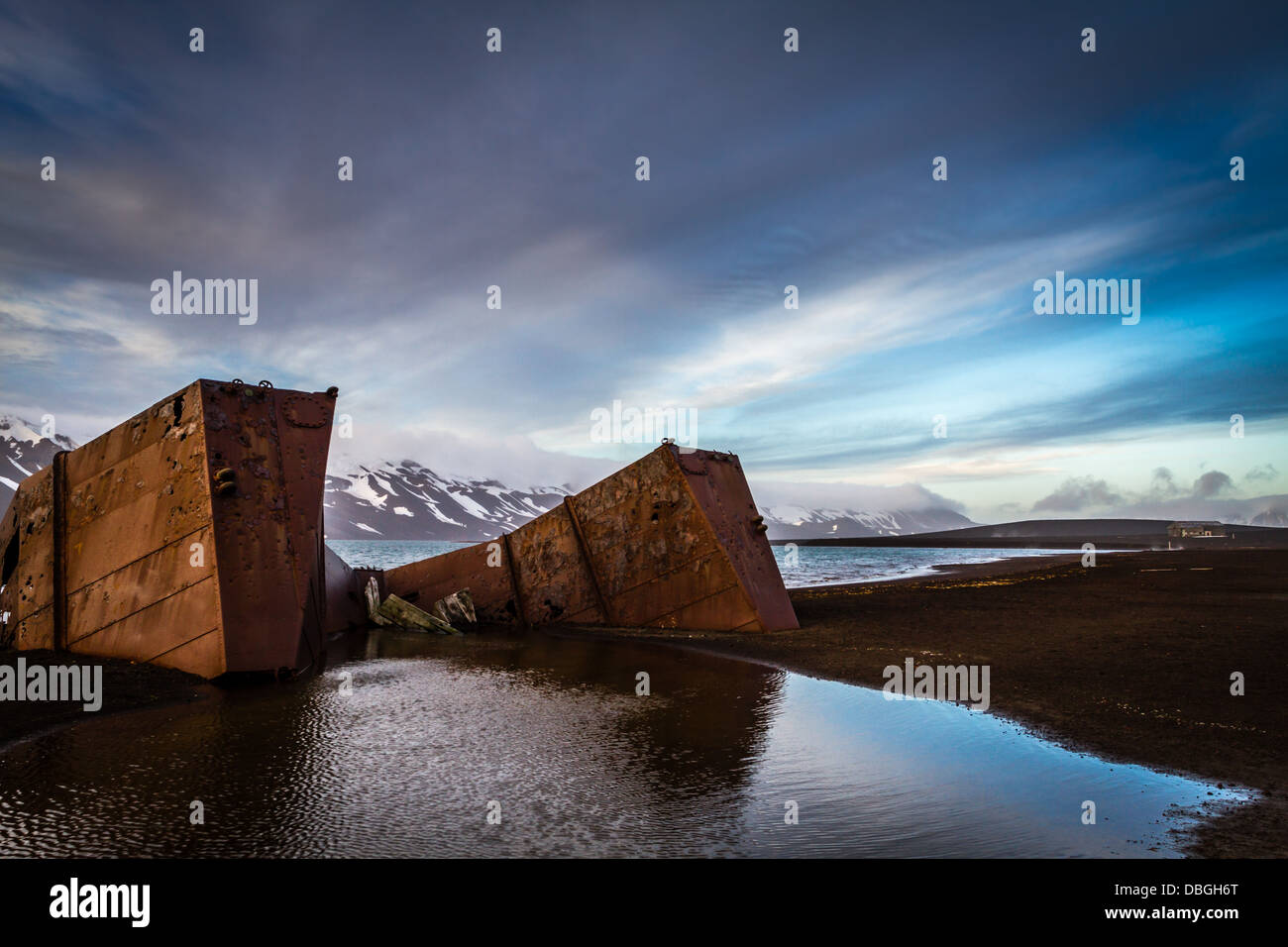 The natural harbour, live volcano and old whaling station of Deception Island, Antarctica  (subantarctic) - Stock Image