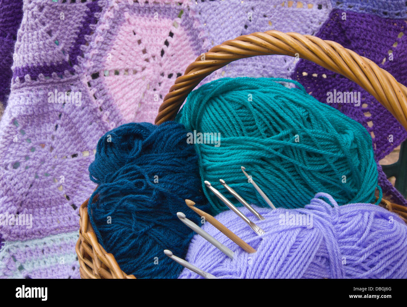 Crochet Work Hexagon blanket, Wools, Basket and Crochet Hooks - Stock Image