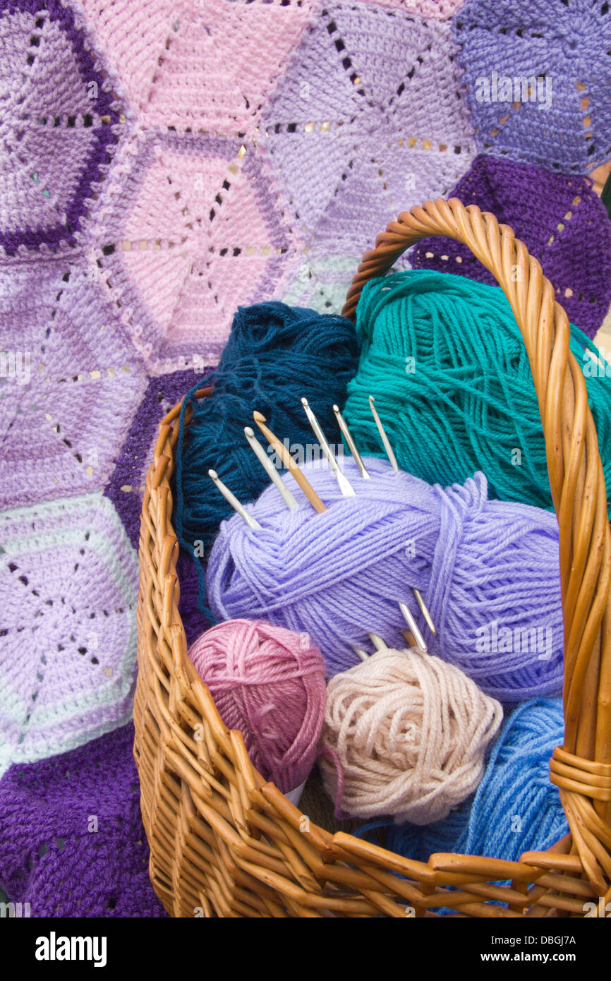 Hexagons of Crochet Work with basket of wools and hooks - Stock Image