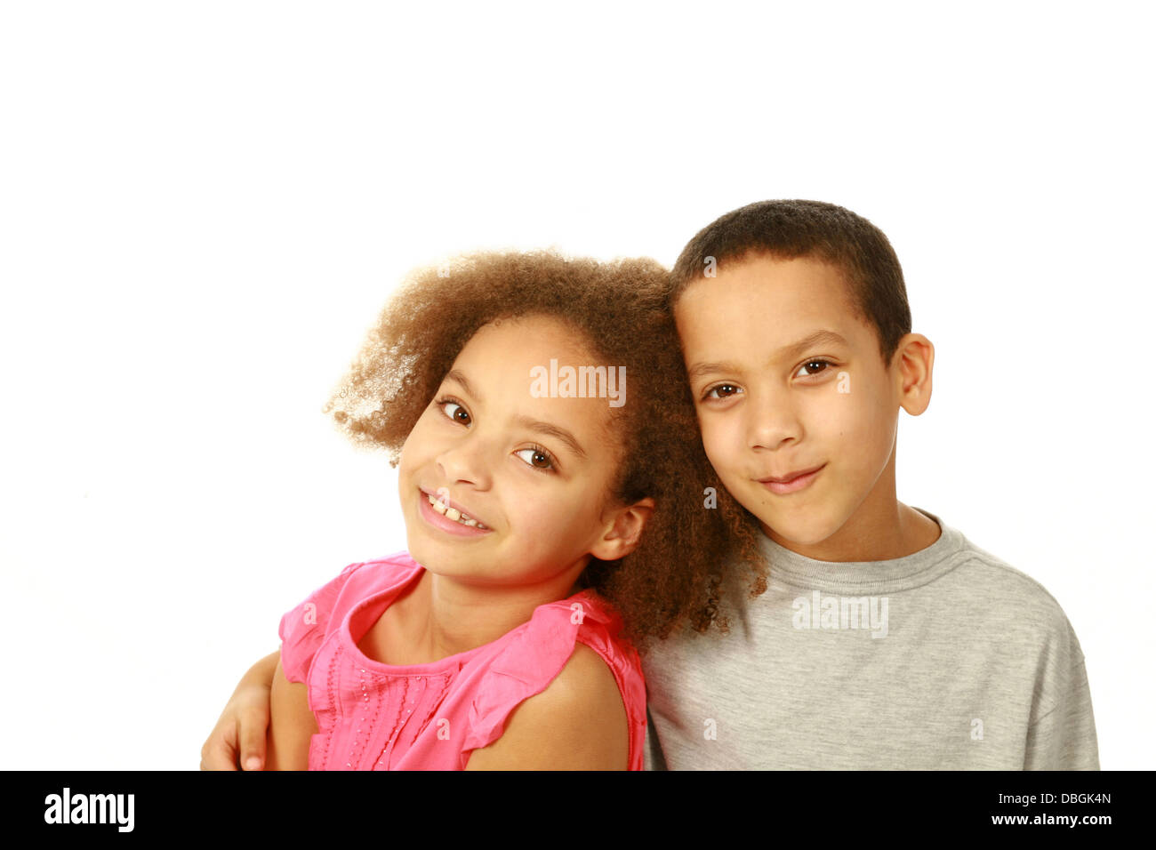 smiling black children hugging with copy space - Stock Image