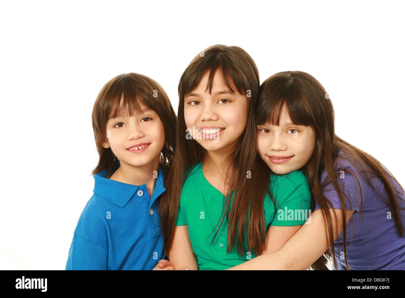 small group of asian children hugging with copy space Stock Photo
