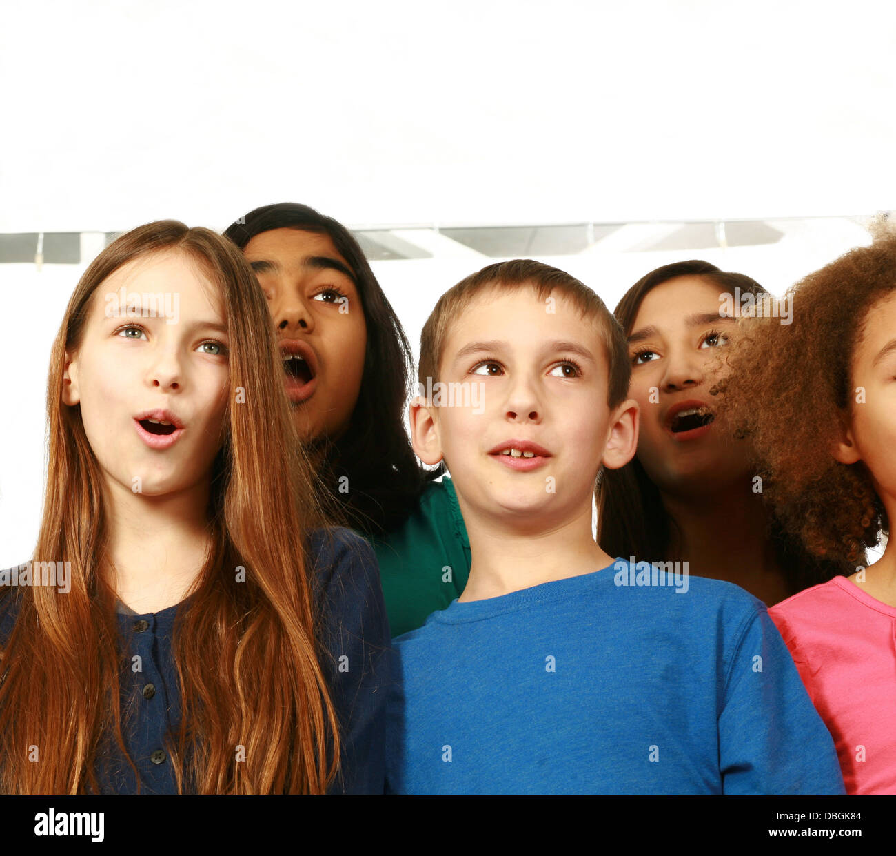multi-ethnic group of children singing with copy space - Stock Image