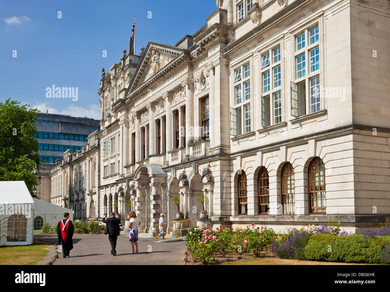 Graduate in robes with parents outside the Administration building University of Wales Cardiff Glamorgan South Wales - Stock Image