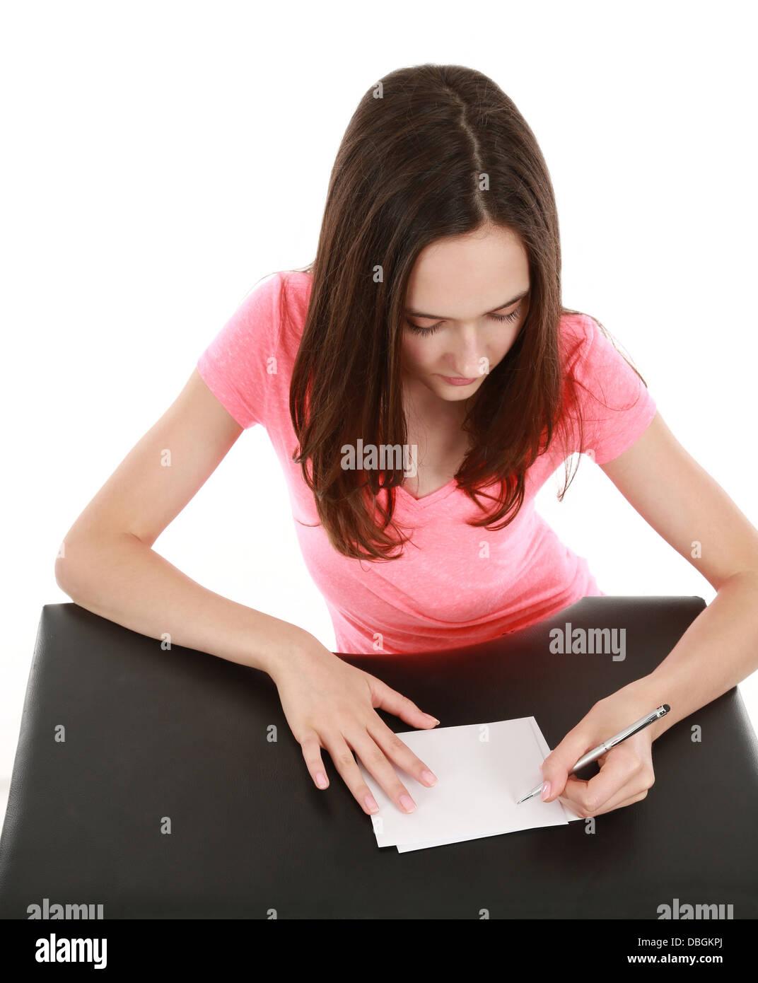 beautiful girl tween model writing letter - Stock Image