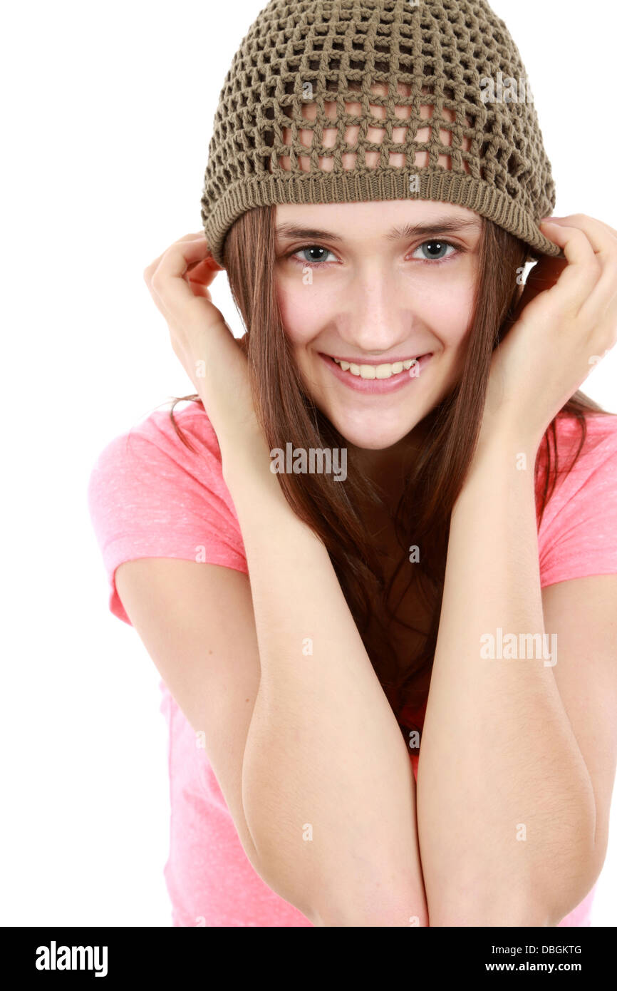 close up of tween girl smiling in hat - Stock Image