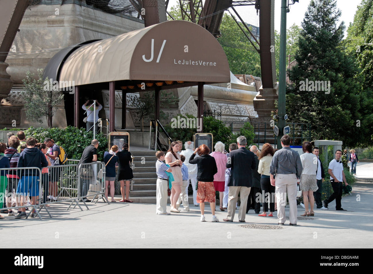 Queues Of People Waiting To Enter The Jules Verne Restaurant In The